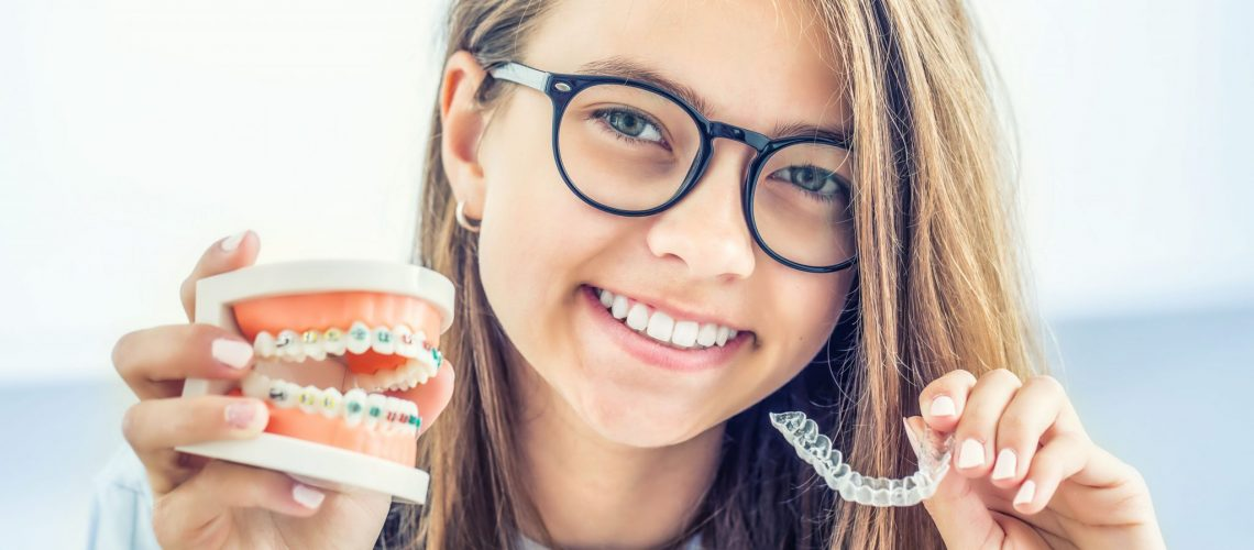 Woman Comparing Braces And Invisalign